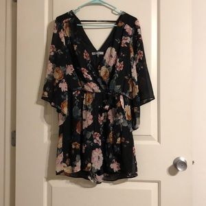 Bailey Blue black floral romper with sheer sleeves